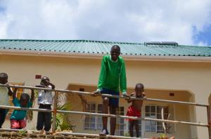 Godknows & some of the STEKA children in front on their new home with Solar power!